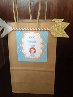 Paper favor bags at a Brave birthday party! See more party ideas at CatchMyParty.com!
