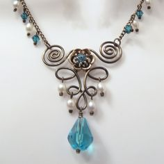 Romantic Necklace Set with Fleur De Lis Wire Work and Swarovski Crystal Slider Beads - Aqua Crystals and White Rice Pearls. $42.50, via Etsy.