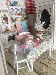 A personal favorite from my Etsy shop https://www.etsy.com/listing/475335016/miniature-dollhouse-pink-and-white