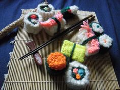 And, of course... knitted sushi. I doubt it tastes as good as the real stuff. Lucifas Stuff on Etsy