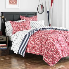 Chic bohemian style is easy to achieve with this Poppy Fritz Morgan Cotton Medallion Comforter Set. This set features a beautiful medallion pattern in pink with a blue and white stripe reverse pattern