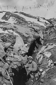 Italian frontline troops in their mountain trenches amid the snow and barbed wire. The harsh terrain made supplying the troops very difficult. The Italians were also at a disadvantage against well-entrenched Austrian positions--most of which had been set up before the war for border security. The Austrians had carefully plotted the artillery range of every nearby site. They simply waited for the Italians to make a move, then blasted them. - 1916 - The Italian Front