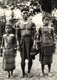 A Kalinga man and his daughters who wear mother of pearl earrings. ( National Geographic Vintage )