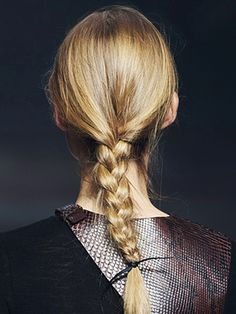 Hairstylists appropriated simple craft-store ribbons and turned them into expensive-looking hair accessories. At Lanvin, hairstylist Julien d'Ys wove clean hair into a basic three-strand plait and secured the ends with a piece of black ribbon. And forget the bows or bells and whistles—d'Ys skipped styling products, tied the ribbon in a double knot, and sent the models on their way.