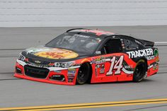 Tony Stewart Photos - Tony Stewart, driver of the #14 Bass Pro Shops Chevrolet, races during the NASCAR Sprint Cup Series GEICO 500 at Talladega Superspeedway on May 1, 2016 in Talladega, Alabama. - NASCAR Sprint Cup Series GEICO 500
