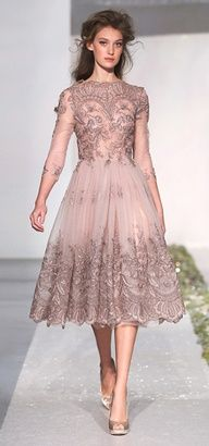 Sheer tulle dusty rose dress with elaborate tonal border embroidery. Long sleeves, fitted bodice, full gathered skirt. By Luisa Beccaria, Autumn/Winter 2012