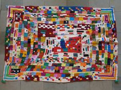 Siiddi Quilt   Photographer: © Henry Drewal     Siddi women in Karnataka are renowned for their quilts. A Siddi quilt (kawandi) is made with the family's discarded clothes. Very colorful and dynamic, the quilts are visually striking.
