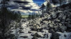 The large and very beautiful Jaipaljukka rock formation was created by melting glaciers and tectonic plate movements towards the end of the Ice Age. Lapland Finland, Natural Wonders, Trail, Clouds, Nature, Outdoor, Beautiful, Outdoors, Naturaleza