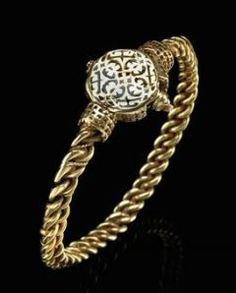 *Seljuk bracelet   11th century   Iran. Woven gold wire, pinned clasp and round bezel with quatrefoil inlaid with niello.