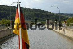 German national flag with sluice watergate and incoming boat on Main-Danube-Canal near Berching Bavaria Germany