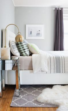 Rumi Neely knows that nothing feels better on bare feet than a soft sheepskin rug. Instead of buying a large version, try layering two smaller sheepskins on either side of the bed. Getting up in the morning will feel that much sweeter! Source: Tessa Neustadt via Homepolish