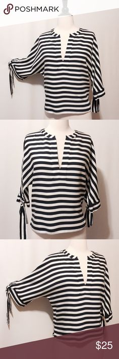 "HP  Zara Navy & White Stripe Blouse NWOT  11/5 Best in Tops Host Pick by @ginger_nj  Amazing! Nautically stripes, batwing three quarter sleeves with tie, side slits. 100% Viscose Dry clean only 40"" bust 22""overall length Zara Tops Blouses"
