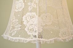 I love the look of lace covered lamp shades I started with a thrift store pole lamp table Then sprayed it with Heirloom w...
