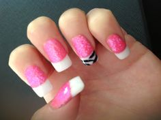 Glitter Nails -  First apply sticky tape to white tip apply a coat of Revlon No: 130 Candy - then remove tape and sprinkle a fine dust of pink glitter over the wet polish , using a fine   nail brush paint zebra stripes to white tip Can be done in any colour combo.