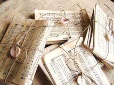 Sheet music tied up with twine and a button.