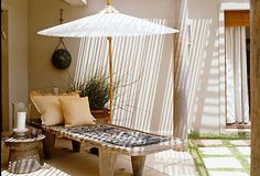 Love this look for patio and love the teak furniture faded grey
