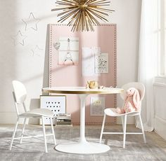 """RH Baby & Child's """"Daphne"""" Play Table - Reg.:  $499 / Sale: $449 /Member: $359   Inspired by the iconic midcentury-modern original, our interpretation features a lacquered tabletop edged in brass for a feminine flourish. Its gently curved column rests upon a pooled metal pedestal, its open profile easily accommodating extra chairs during play dates for the pint-sized."""