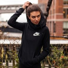 Nike Black Rally Funnel Neck Hoodie •The Nike Rally Funnel Neck Pullover Women's Hoodie features a crossover hood and warm, French terry fabric for premium protection from the elements.  •Size S, true to size.  •New with tag.   •NO TRADES/PAYPAL/MERC/HOLDS/NONSENSE. Nike Tops Sweatshirts & Hoodies