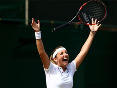 Timea Bacsinszky of Switzerland celebrates match point against Monica Niculescu of Romania.  Clive Brunskill, Getty Images