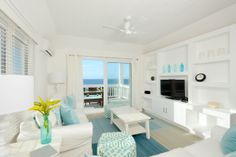 Crisp and beachy living room overlooking the Caribbean at Sapodilly condo in Eleuthera, Bahamas  http://www.homeaway.com/vacation-rental/p3603836