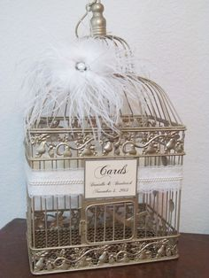#BirdCageWeddingCard Shop -  #BirdcageWeddingCardholder in Champagne With White Feathers, Lace  http://www.birdcageweddingcardshop.com/birdcage-wedding-cardholder-in-champagne-with-white-feathers-lace-pearls-customized-lgd003/