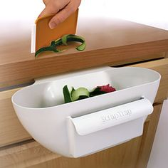 How great is this? Scrap Trap helps keep your counter and sinks clean while you prepare meals.
