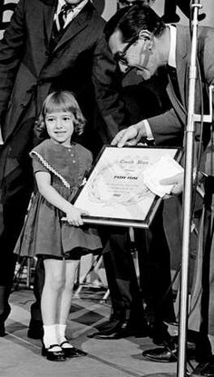 Julie Dick, 5, also picking up the Cash Box award for her late mother, Patsy Cline, at the opening breakfast of the 12th annual Country Music Festival at the Municipal Auditorium, Nov. 1, 1963.
