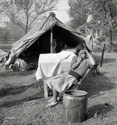 "Lady of the Flies: November 1936. ""Children and home of migratory cotton workers. Migratory camp, southern San Joaquin Valley, California."" Medium format nitrate negative by Dorothea Lange"