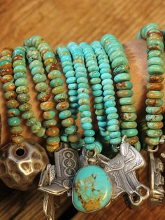 Western Charm Stack. Turquoise, fun charms, and lots of them. Arm candy goes wild. Kembrel has lots of accessories. Take a little peek:)