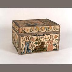 A 17th Century needlework casket,  of rectangular form, worked in coloured silks and metal threads having speckled sequin detailing. This box purportedly belonged to the court of King Charles II and was presented to Jane Lane after she assisted him in fleeing Britain after being defeated at the battle of Worcester in 1651. The box was then handed to Jane's sister Anne Birch and it was through this family that the box was passed down from generation to generation.