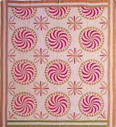 Antique pinwheel quilt.  The tan is not a great choice with the pink, but the shapes are so cool.  Also, mitered corners would look better than what was done here.