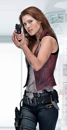 Resident Evil 4 Movie Claire Redfieled Stylish Leather Vest  Jacket Features:  Outfit type: Leather Vest  Gender: Female  Color: Brown  Front: Front Zip Closure  Lining: Viscose Lining