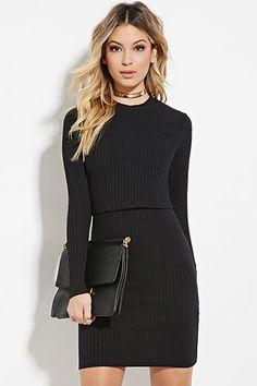 A combo dress crafted from ribbed knit featuring long sleeves and a crew neckline.