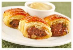 Ground lamb and Moroccan-inspired herbs and spices combine to make the filling for these tasty pastry-wrapped appetizers.