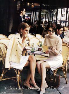 Bridget Hall with Kylie Bax styled by Brana Wolf wearing : APC sweater | Alberta Feretti skirt |  Calvin Klein eyewear | Prada sabrina heels | Pamela Hanson for US VOGUE January 1996.