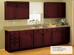 Kitchen Ideas:  Rustoleum Cabinet Transformations - Cabernet Glazed.  Counter: Desert Sand.  Brushed nickel hardware and stainless steel appliances & a nice backsplash would make it look way nicer.