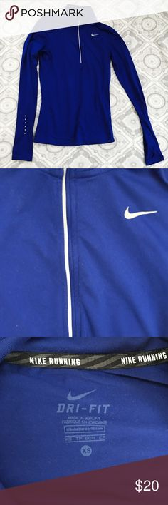🏃🏼♀️nike run zip🏃🏼♀️ half zip stretchy nike running top in cobalt blue. less than a year old. reflective dots on arms and zipper. great base layer. thumb openings. size xs but i wear as a size 4. Nike Jackets & Coats