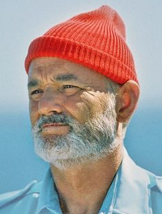 Old Man Wearing Red Beanie & Blue Shirt