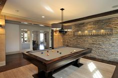 cool accent walls | The natural stone walls are definitely the stars in these rooms.