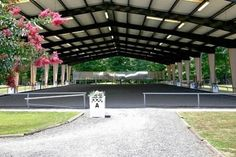Covered riding arena with landscaping