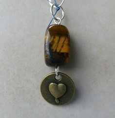 Check out this item in my Etsy shop https://www.etsy.com/listing/238608664/bronze-color-double-sided-heart-love