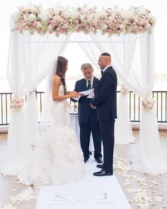 Vows. This wedding is a fan favorite....With good reason!  Photo by J&Photography  Las Vegas Wedding Planner @andreaeppolito  Chuppah @naakitifloral  Venue @westinlakelasvegas