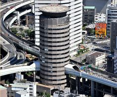 Highway penetrates the building. Osaka, Japan