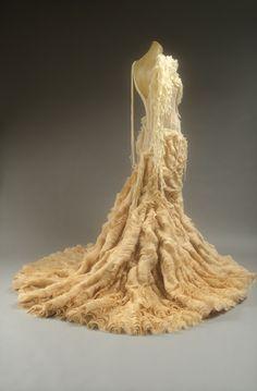 A. McQueen s/s 2003. Shredded ivory silk chiffon & tiered silk organza. The Metropolitan Museum of Art.