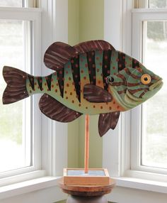 New to Rachel Laundon Art! Our colorful folk art fish collection are no longer confined to swimming on the wall. With our new attractive bases created by the artist from Vermont green slate, cherry wo