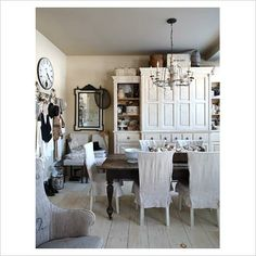 Love the Welsh cupboard and chair covers!