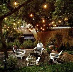 Love the Edison Lightbulbs in the trees - Backyard firepit