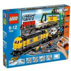 LEGO City Cargo Train 7939 by LEGO City. $142.73. Cargo train features an engine, tank wagon, flatbed container wagon and auto carrier wagon with 2 small cars. Big crane fits over tracks and container truck and features a working winch. Set features Power Functions battery box, infrared receiver, motor and 8-channel, 7-speed, infrared remote control that controls up to 8 different trains simultaneously. Includes 4 minifigures: 1 train driver and 3 freight yard workers. Track are ...