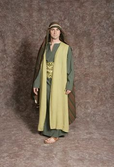 $20.00 Nativity Man #6 dk. green tunic, long lt. green vest, green patterned sash, green striped headpiece