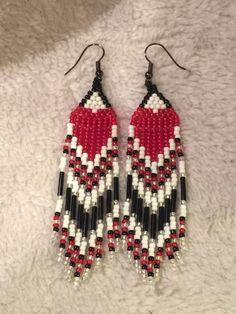 A personal favorite from my Etsy shop https://www.etsy.com/listing/229275653/handmade-beaded-heart-earrings
